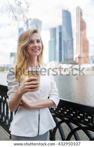 Young beautiful girl with coffee to go