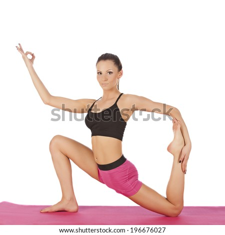 young beautiful girl yoga posing on a white studio background