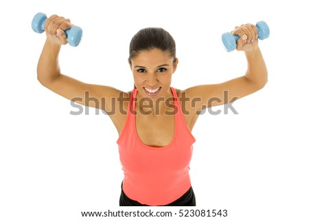 young beautiful happy hispanic woman in sport clothes with beautiful smile holding weight dumbbell doing fitness workout isolated on white background in healthy lifestyle concept