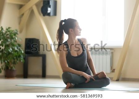 young black woman doing yoga home stock photo 401693095
