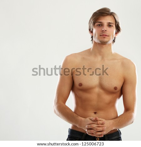 Young beautiful man with naked torso isolated over white background