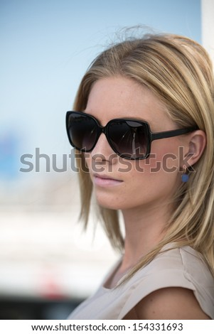 Young beautiful modern woman with sunglasses