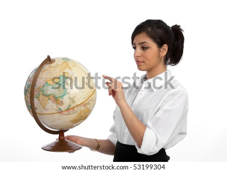 Young, beautiful professional planning her career travel, spinning a globe