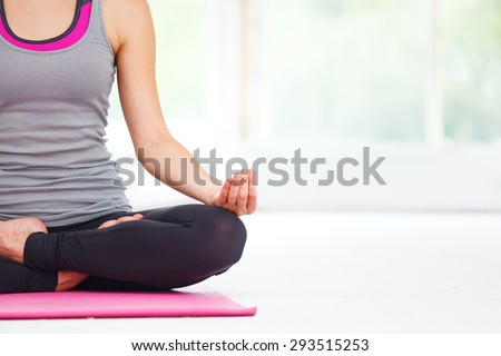 Young beautiful woman doing yoga indoors.