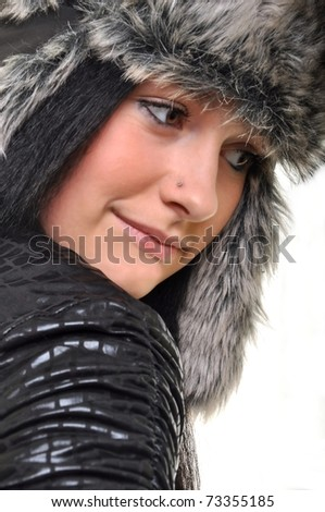 young beautiful woman, dressed as russian cap