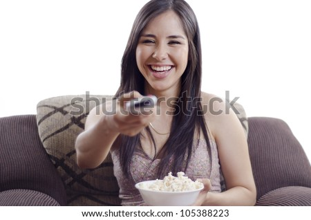 Young beautiful woman enjoying a movie and eating snacks