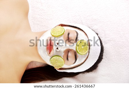 Young beautiful woman enjoying spa