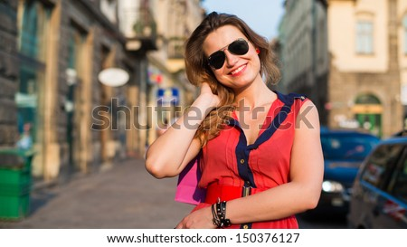 Young beautiful woman in city.