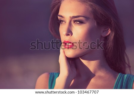 young beautiful woman portrait outdoor, sunlit