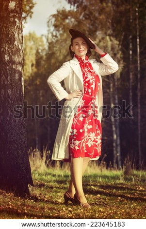 Young beautiful woman posing in vintage clothes