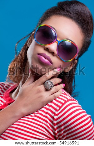 Young beautiful woman wearing vintage sunglasses
