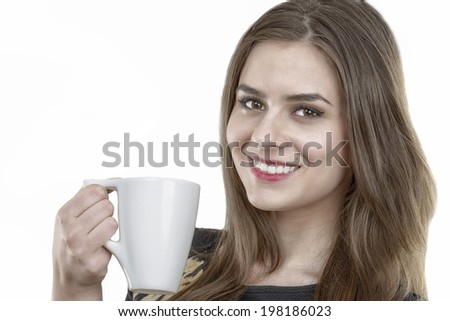 young beautiful woman with a cup of coffee in hand