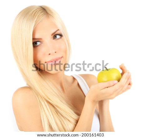 Young beautiful woman with apple isolated on white