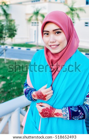 Young beautiful woman with henna design in their hands