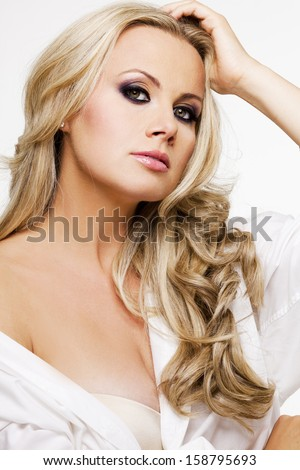 Young beautiful woman with perfect skin and blond hair.