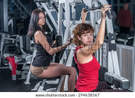 Young beautiful women training in fitness center