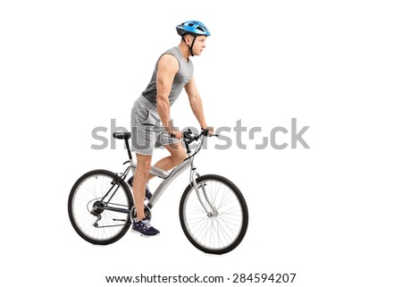 Young biker with a blue helmet on his head riding a bicycle isolated on white background