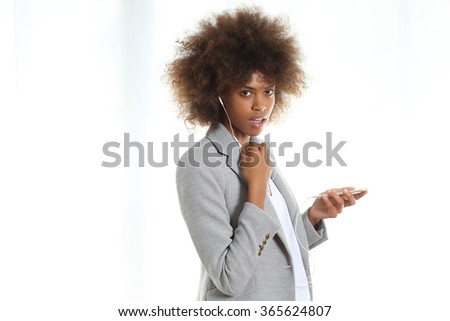 Young black girl speaking using her phone