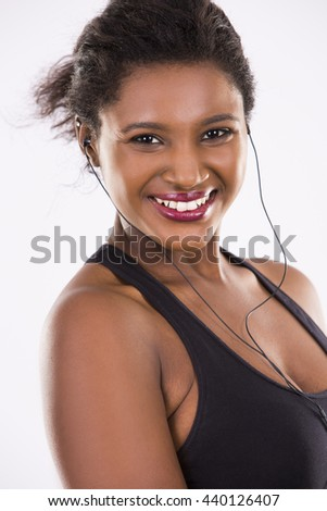 young black woman wearing fitness outfit on white isolated background