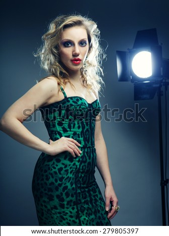 young blond fashion model posing in studio