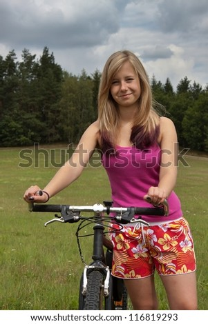 young blond girl on a bicycle trip