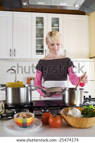 young blond woman cooking in the domestic kitchen