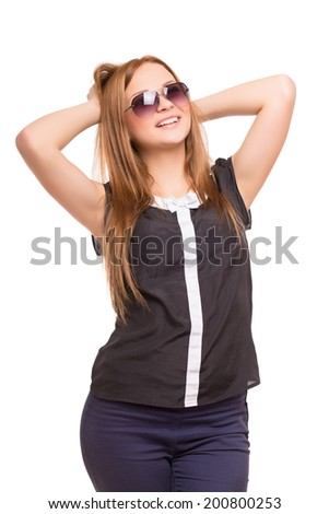 Young blond woman posing in cheerful. Isolated