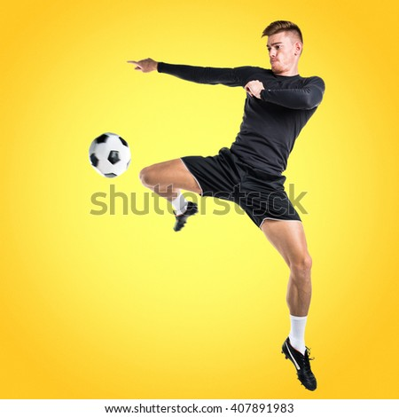 Young blonde man playing football