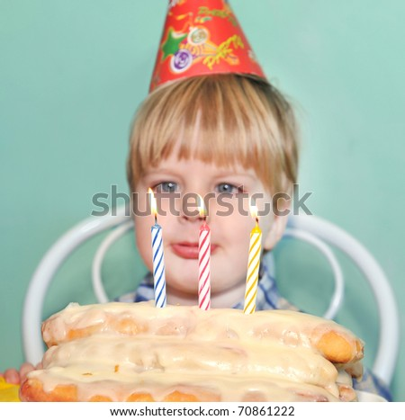 Young boy blowing birthday candles