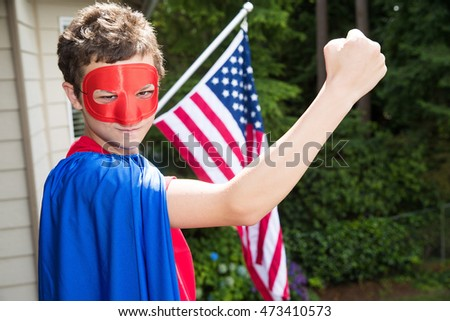 Young boy in a superhero costume