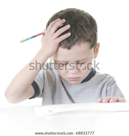 young boy showing stress with school work