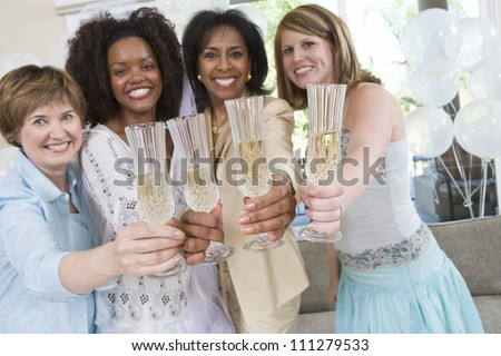 Young bride celebrating party with friends and mother at home