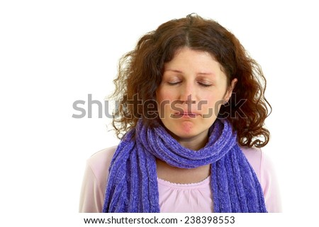 Young brown-haired woman with wool scarf isolated on white background, studio shot.