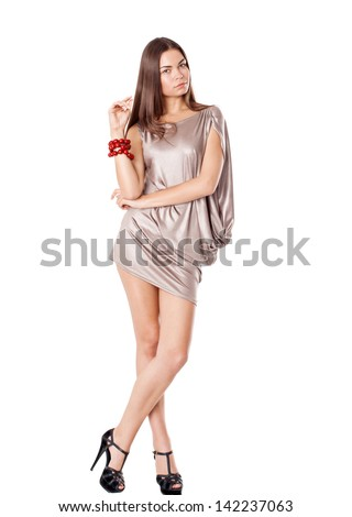 Young brunette lady in latte dress posing on white background