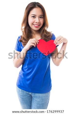 Young brunette woman holding red heart on white background, Love and valentines day concepts.