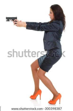 Young brunette woman with gun isolated on white full length