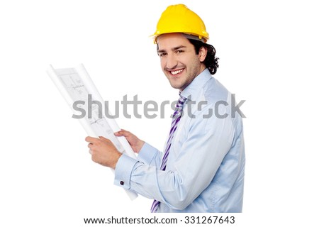 Young builder holding the blueprint
