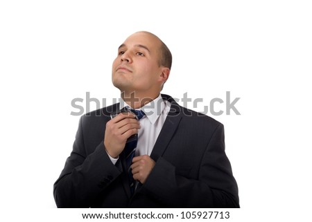 Young business man fixing his tie before going to work