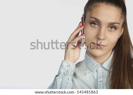 Young business woman and talking with mobile phone