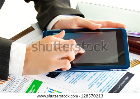 young business woman hands in office holding tablet pc
