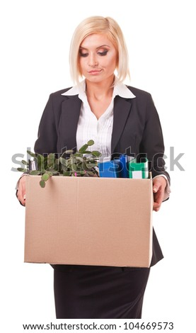 young business woman holding a box of belongings and documents
