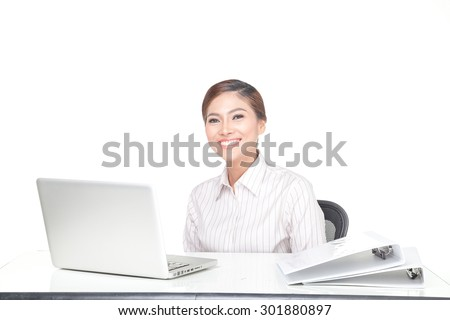 young business woman smiling when working on desk, isolated on white background