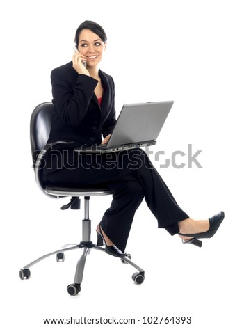 Young Business Woman Using Telephone and Laptop
