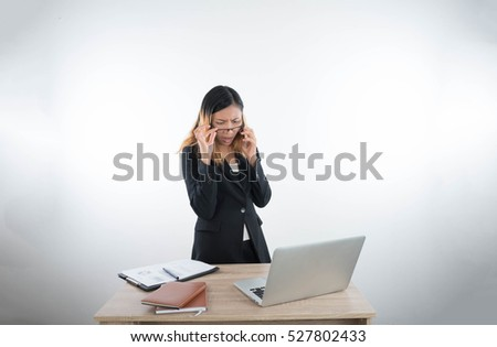 Young business woman with laptop notebook and smartphone in the office