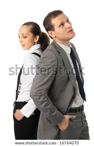 Young businessman and businesswoman standing back to back