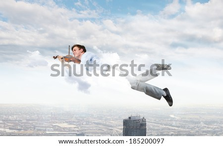 Young businessman flying in sky and playing fife
