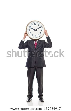 young businessman holding a clock, isolated image