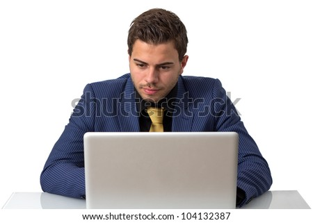 Young Businessman in a Blue suit Working on He's Notebook