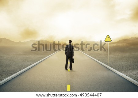 Young businessman in suit standing on road with forward sign on abstract landscape background. Leadership concept. 3D Rendering