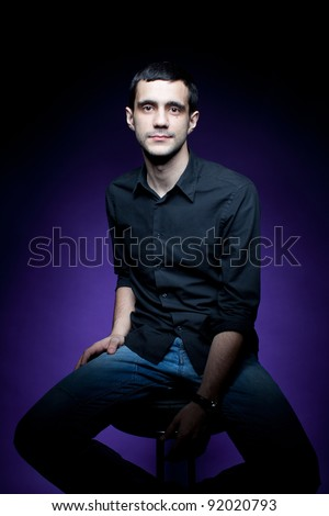 Young businessman, isolated on purple background